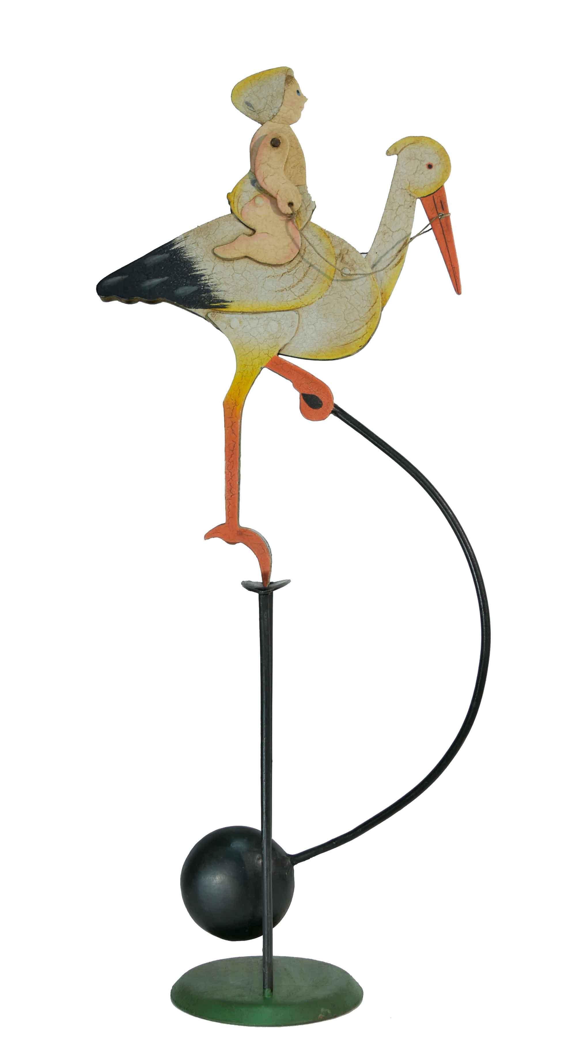 Balance Figur Baby auf Storch